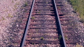 Railroad. Railway tracks from moving train. Travelling background. Railroad. Railway tracks from moving train. 1080p stock video footage