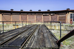 Railroad Roundhouse. Old brick railroad roundhouse and turn table at semi abandoned rail yard Royalty Free Stock Images