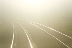 Railroad seeking. To distance in fog Stock Images