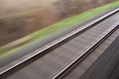 Railroad seen from a fast moving train. Royalty Free Stock Image