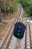 Railroad and semaphore with green signal Stock Images