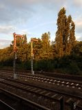 Railroad semaphore in the twilight of day. Alarm columns on the railroad in the twilight of day royalty free stock photo
