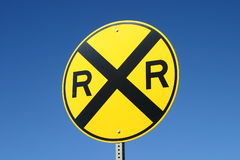 Railroad sign. A railroad crossing sign on blue sky background Royalty Free Stock Photography
