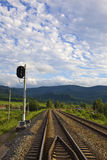 Railroad signal and tracks royalty free stock photography
