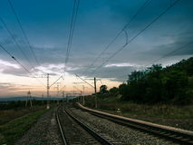 Railroad and sky. Summer evening landscape electrified railway Stock Photos