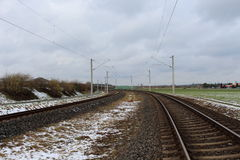 Railroad in snow with blue sky Royalty Free Stock Images