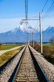 Railroad on Sorsko feld. And Kamnik Savinja alps in the background Royalty Free Stock Photos