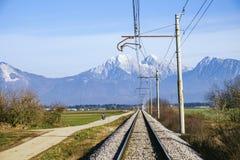 Railroad on Sorsko feld. And Kamnik Savinja alps in the background Royalty Free Stock Image