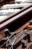 Railroad spike sticking up. Rusted and dilapidated railroad tracks with a loose spike sticking out Stock Images
