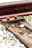 Railroad spike sticking up. Rusted and dilapidated railroad tracks with a loose spike sticking out Stock Photography