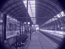 Railroad Station Platform. In Europe the best way to go is by the rails. The is the Amsterdam Station Stock Photos