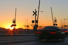 Railroad sunrise. Taken early morning in Las Vegas near airport along sunset road. Cars passing an old railroad crossing royalty free stock photos
