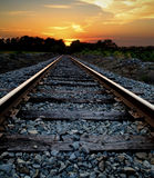 Railroad at Sunset. Abstract journey concept of a railroad heading into a sunset. Many uses including life journeys and religion, God, etc Stock Images