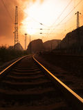 Railroad sunset. A curved electric railroad  in sunset Royalty Free Stock Photography
