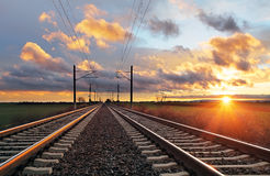 Railroad at sunset. With sun Stock Image