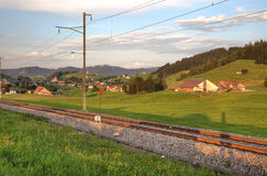 Railroad in swiss Alps. Before sunset Stock Photo