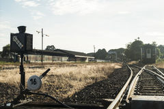 Railroad switch with train in the morning.  Royalty Free Stock Photo