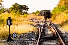 Railroad switch with train in the morning sun. The conception of royalty free stock images