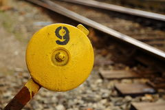 Railroad switch. Yellow railroad switch with number nine Royalty Free Stock Photography