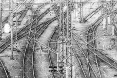 Railroad tangle at large train station. Railway transportation theme. Black and white image royalty free stock photos