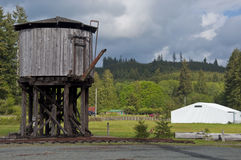 Railroad tank. Old weathered railroad water tank and barn Stock Photography