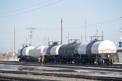 Railroad tanker cars. Some railroad tanker cars for carrying chemicals parked in a train yard Royalty Free Stock Images