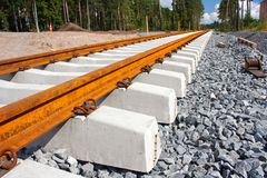 Railroad ties and tracks. Concrete railroad ties in railway construction site Royalty Free Stock Photos