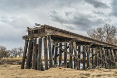 Railroad timber trestle destroyed Stock Photo