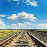 Railroad to horizon in blue sky with clouds Stock Image