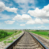Railroad to horizon and cloudy sky Royalty Free Stock Photo