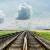 Railroad to horizon in dramatic clouds Royalty Free Stock Photos
