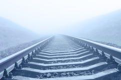 Railroad to horizon in fog Stock Photography