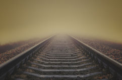 Railroad to horizon in fog Stock Photo