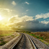 Railroad to horizon and sunset Royalty Free Stock Photo