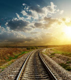 Railroad to horizon in sunset Royalty Free Stock Photos
