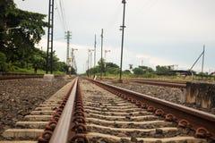railroad to horizon under cloudy sky Stock Photo