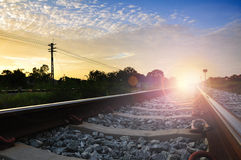Railroad to horizon under cloudy Royalty Free Stock Image