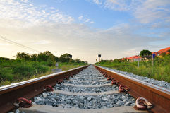 Railroad to horizon under cloudy Royalty Free Stock Photography