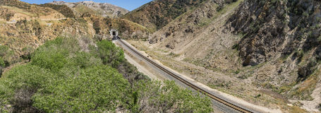 Railroad to Mountain Tunnel Stock Photo