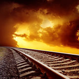 Railroad to orange horizon in sunset Stock Image