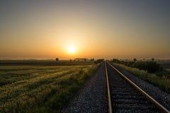 Railroad to sun Stock Photo