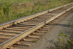 Railroad track. Old railroad track with grass Royalty Free Stock Images