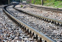 Railroad Track. Disappearing railroad track curve with gray gravel Royalty Free Stock Photography