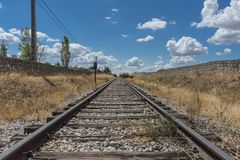 Railroad Track Amidst Trees Against Sky Stock Photography