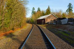 Railroad Track in Aurora Oregon. Roadroad train track in historic antique district in Aurora Oregon on a sunny clear blue sky afternoon royalty free stock photo