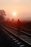 Railroad track during autumn foggy morning Stock Images