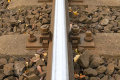 Railroad track bolt as background. Stock Photos