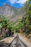 The railroad track crossing jungle and Urubamba river, connecting Machu Picchu village to hydroelectric station, mostly used for t Royalty Free Stock Photos