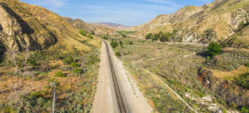 Railroad Track in Desert Wilderness Royalty Free Stock Images