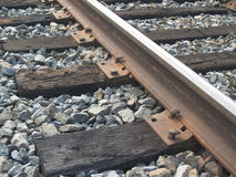 Railroad Track Detail. Closeup view of regular railroad tracks showing their age Stock Image